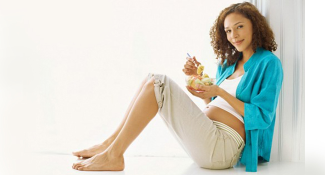 Pregnant woman eating healthily