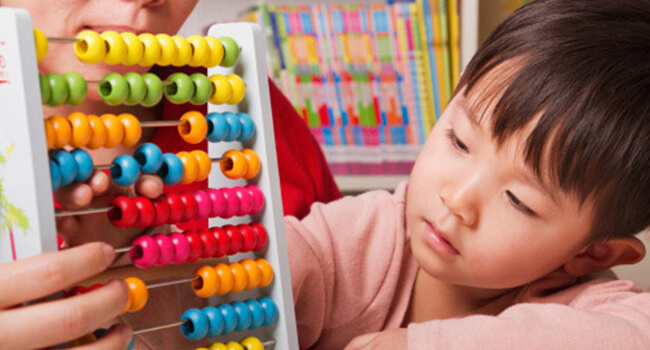 Child Learning Maths with an Abacus